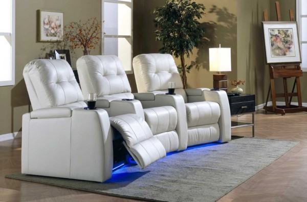 Custom Palliser home theater seating with blue LEDs and white leather.
