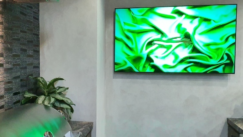 Picture of a Samsung Frame TV in a kitchen with art.