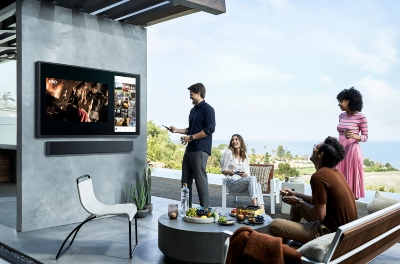 Picture of the Samsung Terrace outdoor TV with its HW-LST70T 3.1 outdoor soundbar.