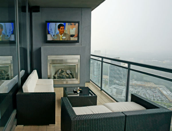 Watching TV high above the city