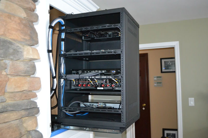 Custom home theater with a clean equipment rack by Innovative Audio Visual, LLC in Erie, PA