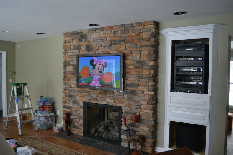 Home Theater system consisting of a custom rack, in ceiling speakers, hidden subwoofer, RTI control system from Innovative Audio Visual, LLC in Erie, PA