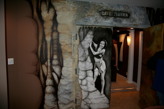 INI AV Gallery - Cave Cinema Entrance Poster