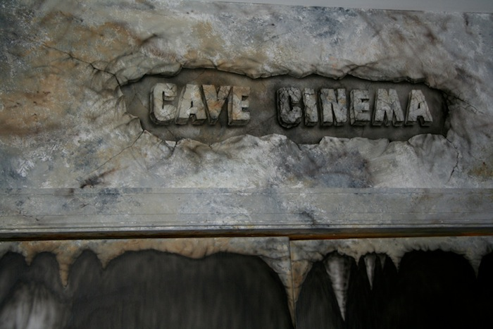 INI AV Gallery - Cave Cinema Logo