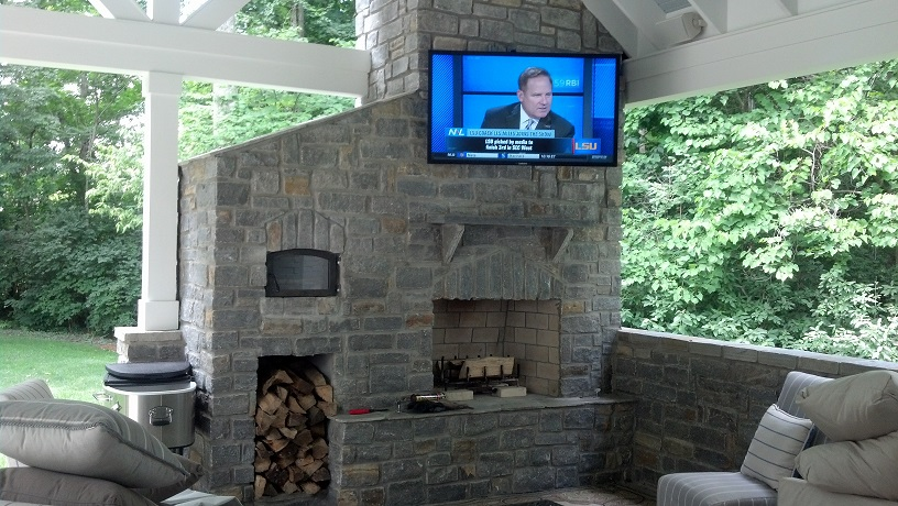 Want to have the ultimate outdoor entertaining area? Check out this install in the Greater Cincinnati install that rounds out this wonderful covered, patio with fireplace. Worried about wi-fi reception? No problem, we can handle that too! Call 513-271-8877 today to schedule a free in-home consultation for all your Audio/Visual needs; including Whole Home Wi-Fi enhancement and extension.