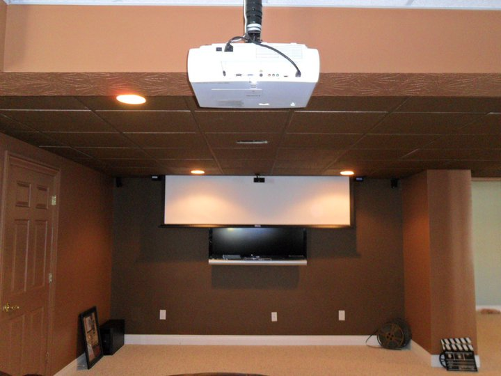 Features Automated Drop-Down Screen that can be kept discreetly tucked away when not in use. This option is excellent for entertaining requires bright light (Flat Panel LED), or when you want to turn the lights down for that full Home Theater Experience (Projection Screen).