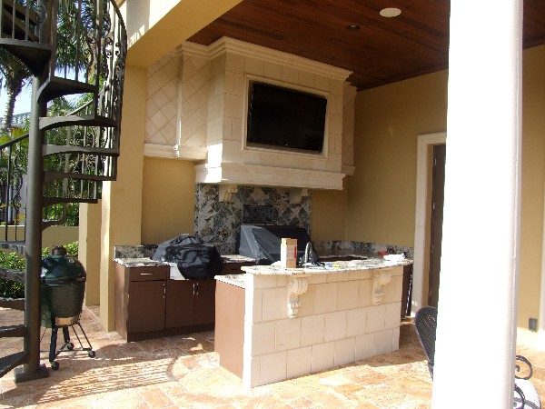 The large TV on the patio can be seen while swimming in the pool as well entertaining on the lanai.