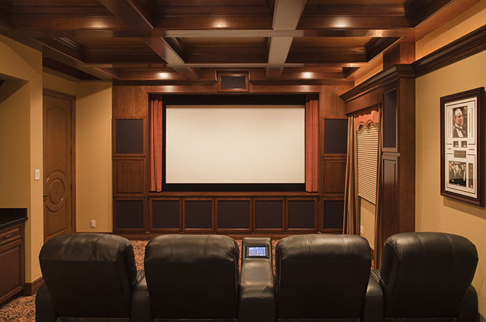 This shot shows the screen, speaker arrangements, touch screen control,and luxury seating.