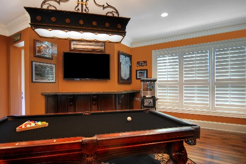 LArge Tv on the back wall behind the pool table