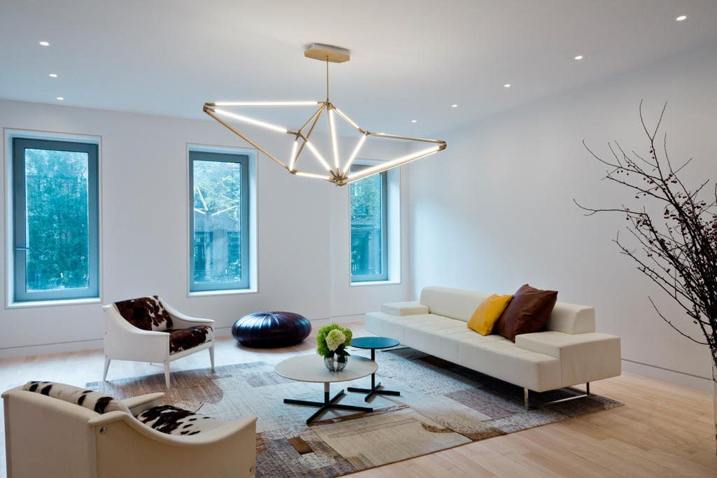 Beautiful room with modern lighting fixture and great lighting design.