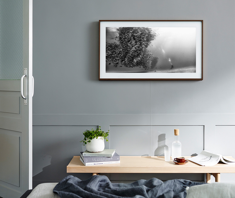 Picture of a 4K Samsung The Frame TV on a gray gallery wall