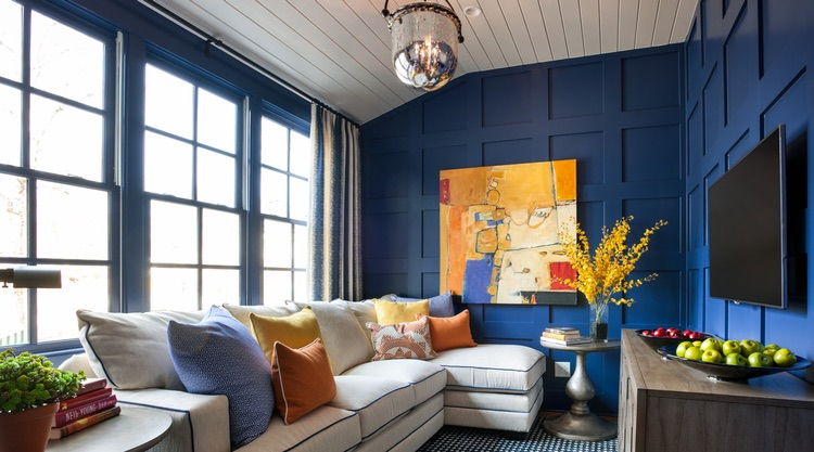 The HGTV smart home features Sherwin Williams Indigo Batik on modern board and batten walls in this modern media room.