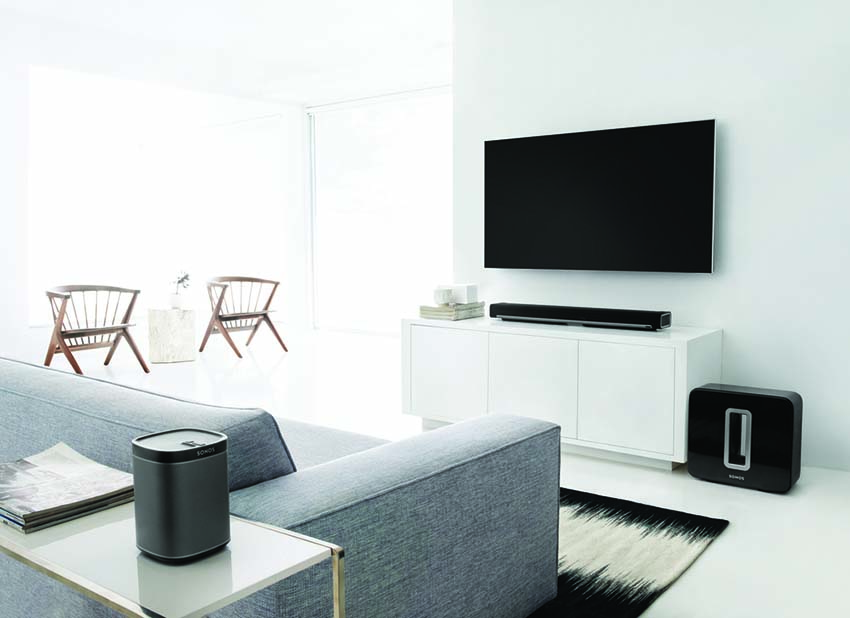 Modern home media room with 4K TV, sonos playbar, sonos sub and sonos play:1 as 5.1 surround sound system.