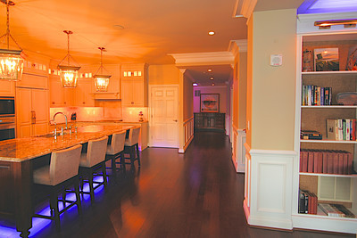 LED lighting under kitchen bar, in den and hall